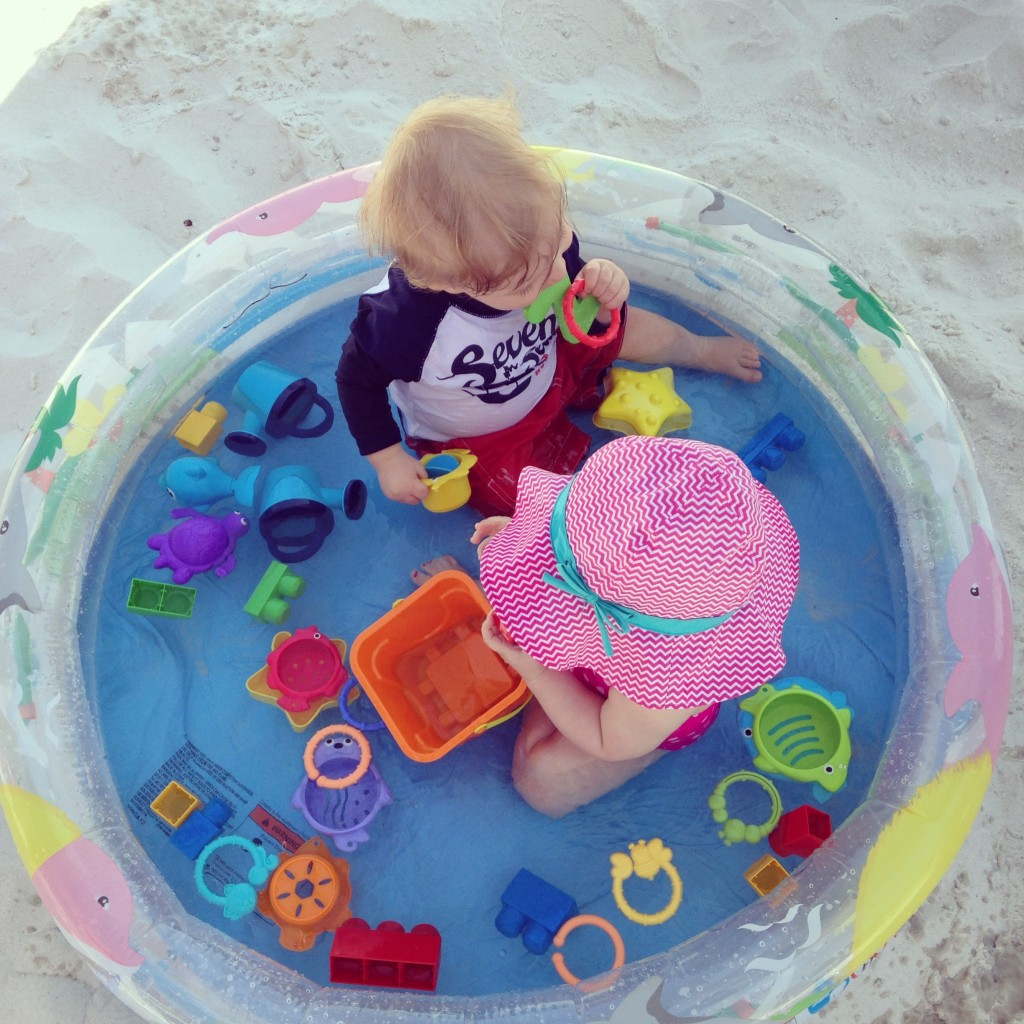 This is Charlee and Hayes in their kiddie pool at the beach.