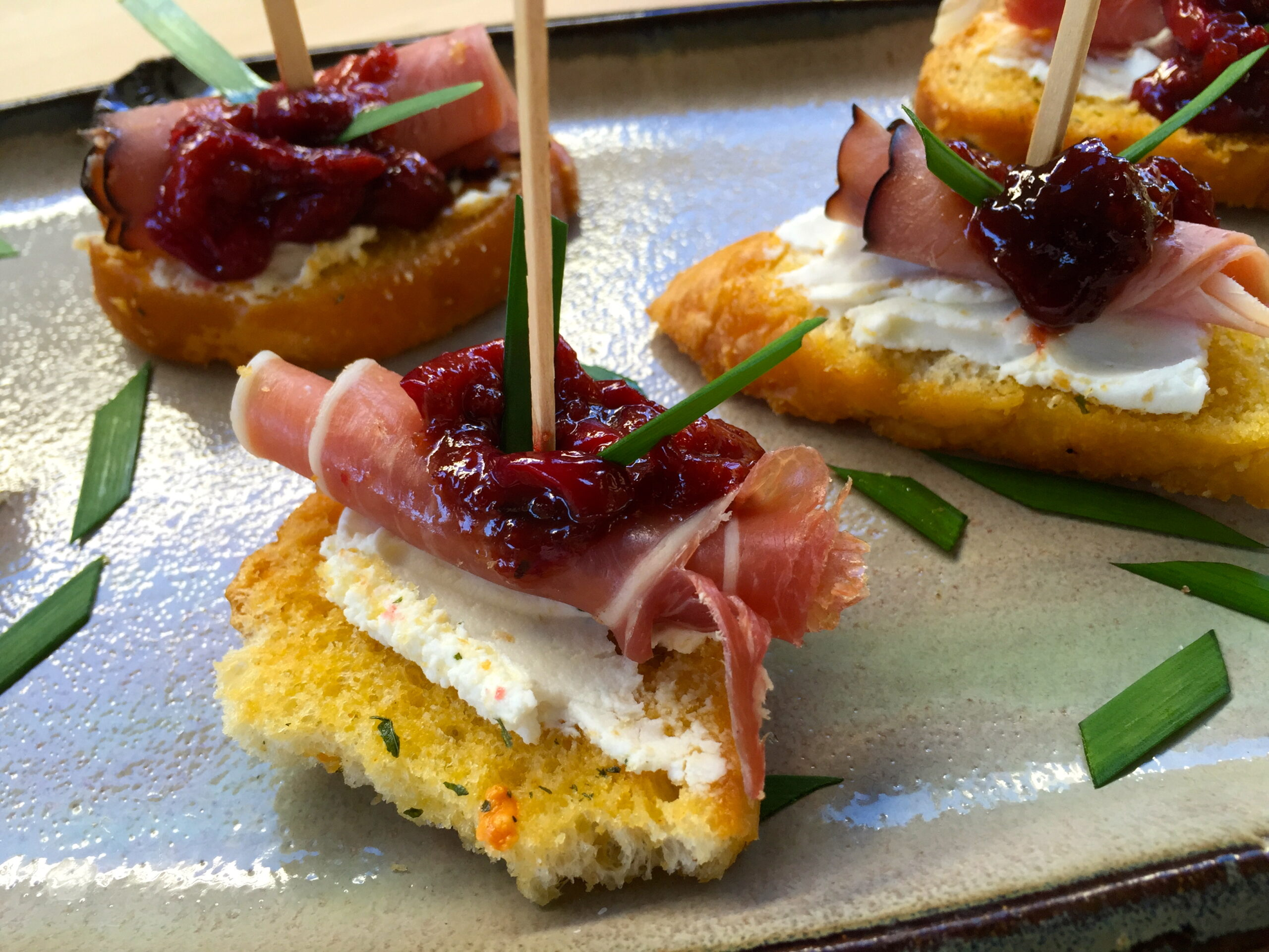 Cranberry, Brie and Prosciutto Crostini