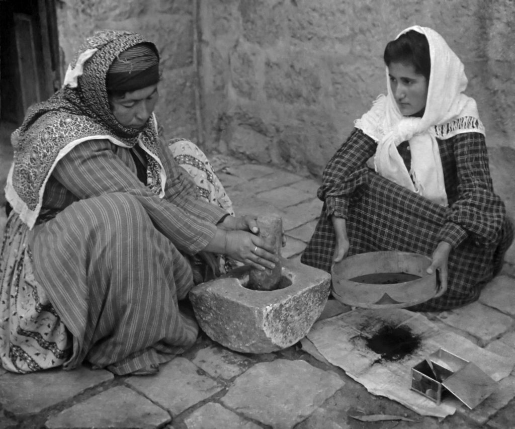 women_grinding_coffee_beans