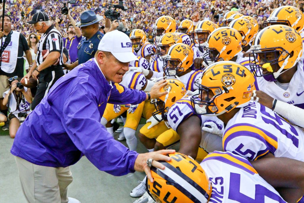 LSU Tigers head coach Les Miles holds back his team before kickoff of a game
